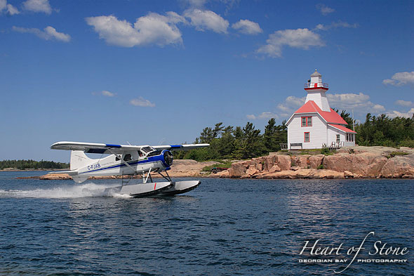 DeHavilland Beaver and Snug Harbour Lighthouse, Snug Harbour, Georgian Bay. Photo by Sean Tamblyn.